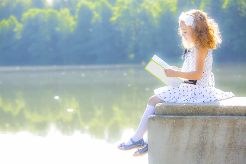 girl_reading_book_outside.jpg