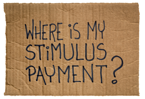 Where is my stimulus payment  Handwriting on a piece of cardboard. Economic recession and relief bill during coronavirus covid-19 pandemic.