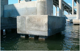 The concrete in this coastal bridge must withstand exposure to salt water for decades.