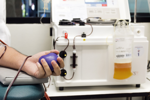 Blood Plasma Donation process_ close up of hand squeezing a rubber ball