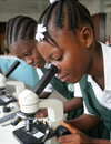Girls looking through microscopes
