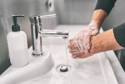 Washing hands rubbing with soap man for corona virus prevention_ hygiene to stop spreading coronavirus.