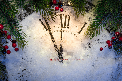 Christmas clock with winter decoration on snow. Happy new year concept