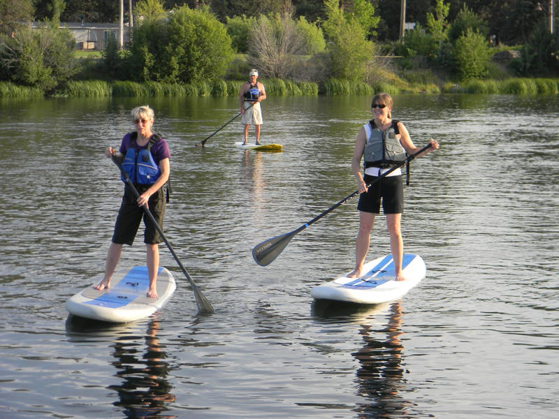 paddle boarders on the lake