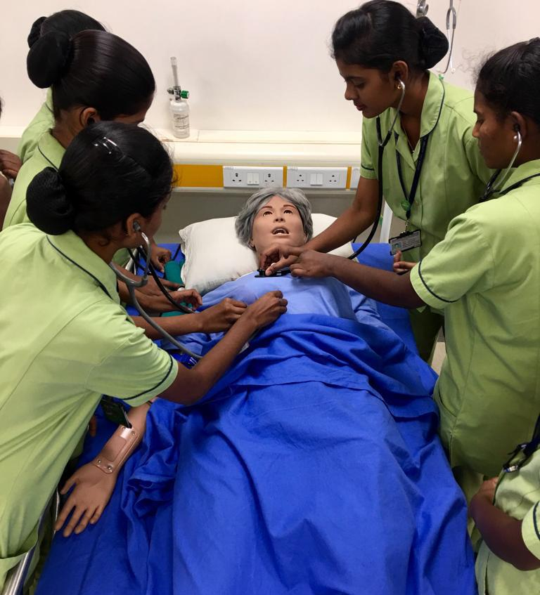 Nursing students practice on simulated patient.