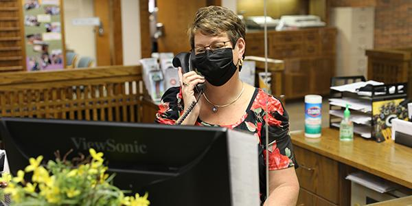 Employee at Desk With Mask