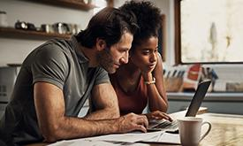 Couple Planning On Computer