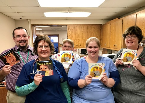 Rugby Teachers holding books