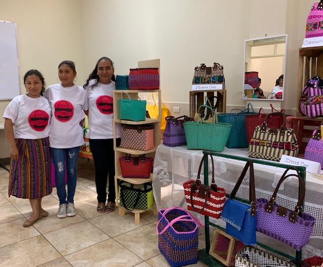3 students exhibit their basket work