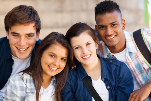 group of happy teen high school students outdoors
