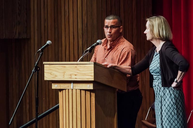 Louie Diaz speaking on stage