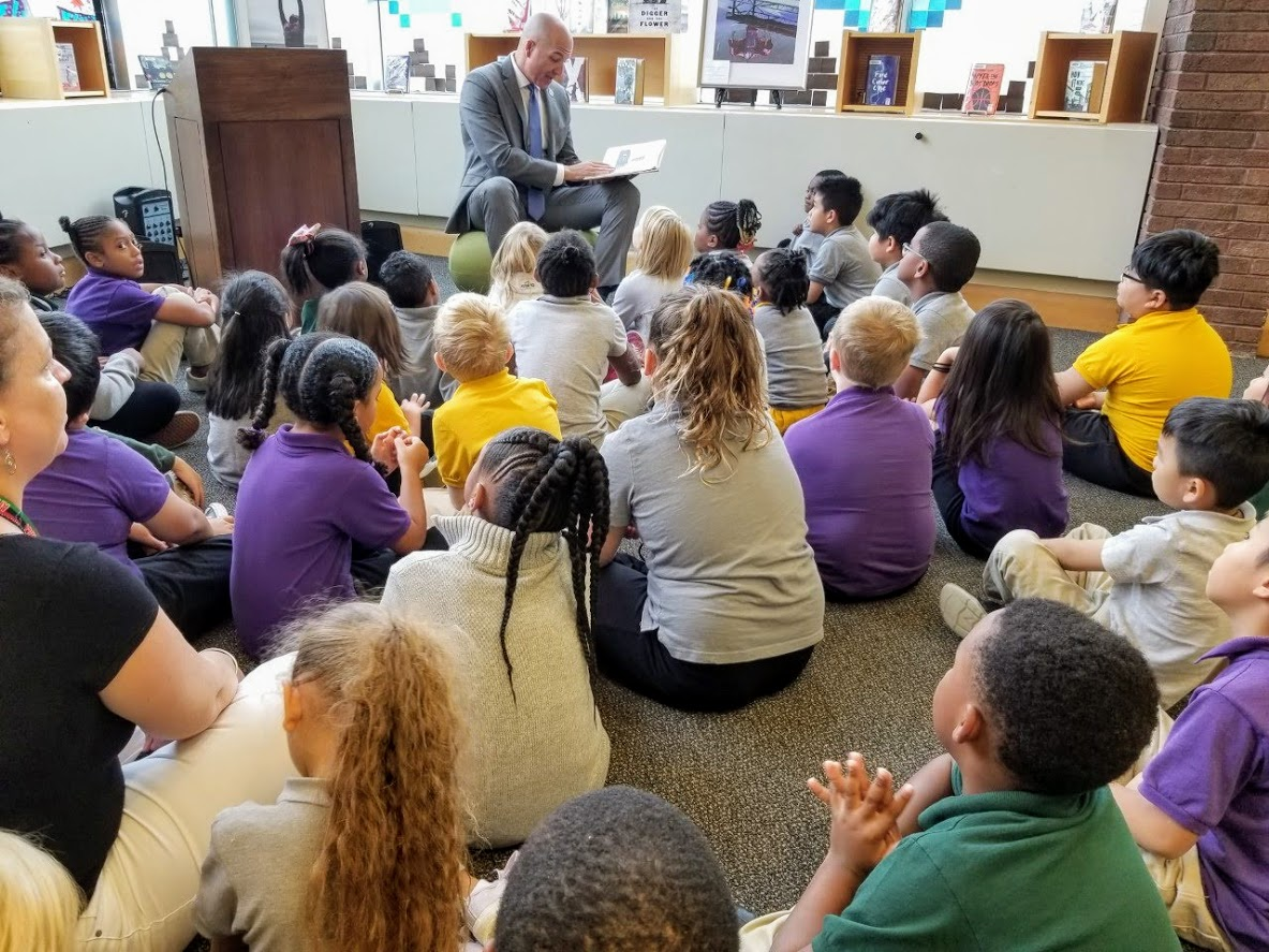 Dr. Gothard reading to students