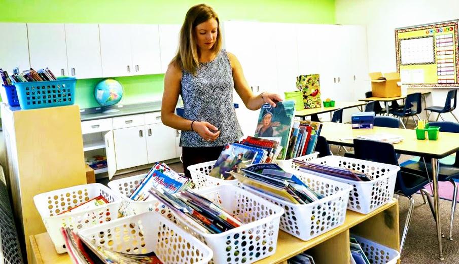 Teacher sorting books