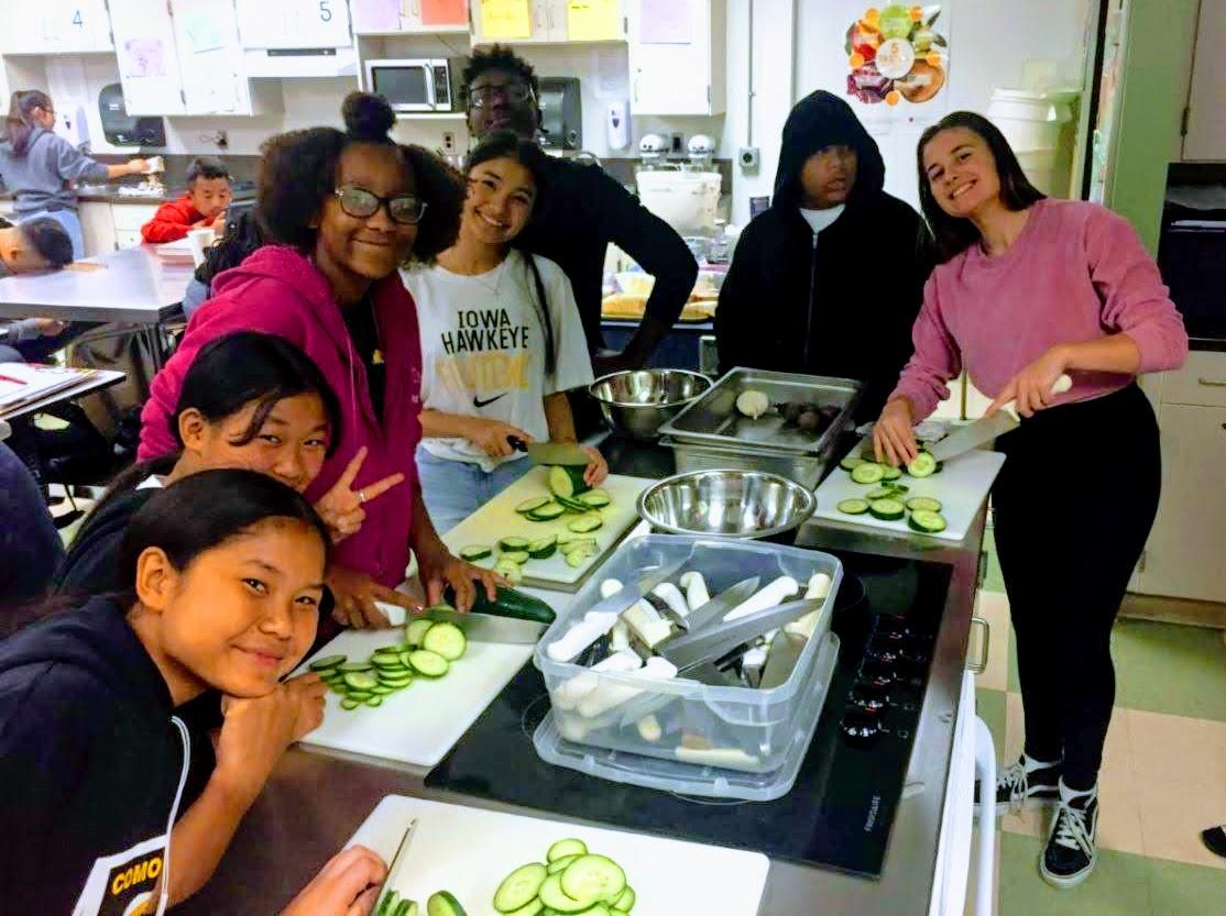 Student cutting veggies