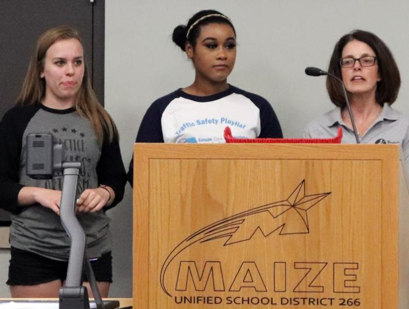 Maize High School students Melanie Pereira and Miyah McGrown presented alongside nurse Dana Desjardins.