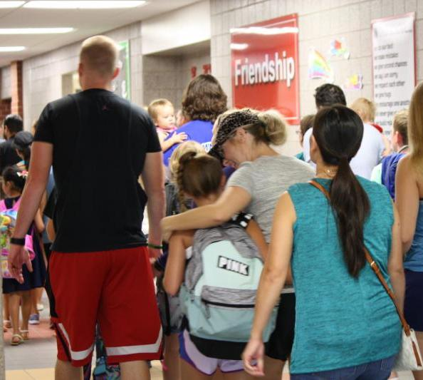 Students and their families file into school on the first day in 2017.
