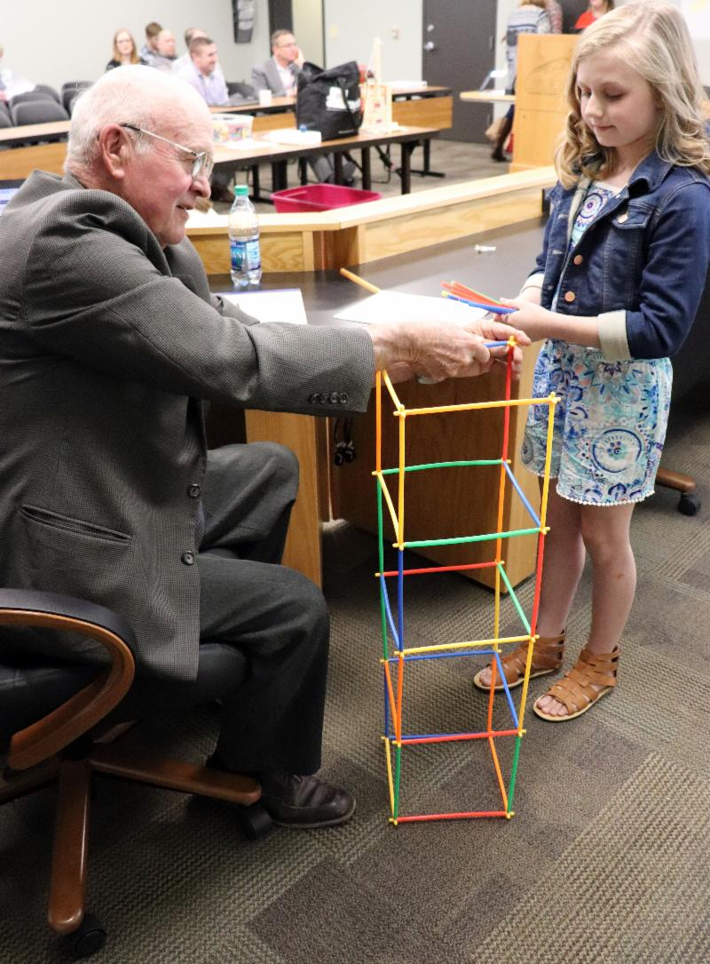 Student Isabelle Sailing enjoys STEAM manipulatives with Maize Board of Education member Bruce Nicholson in April.