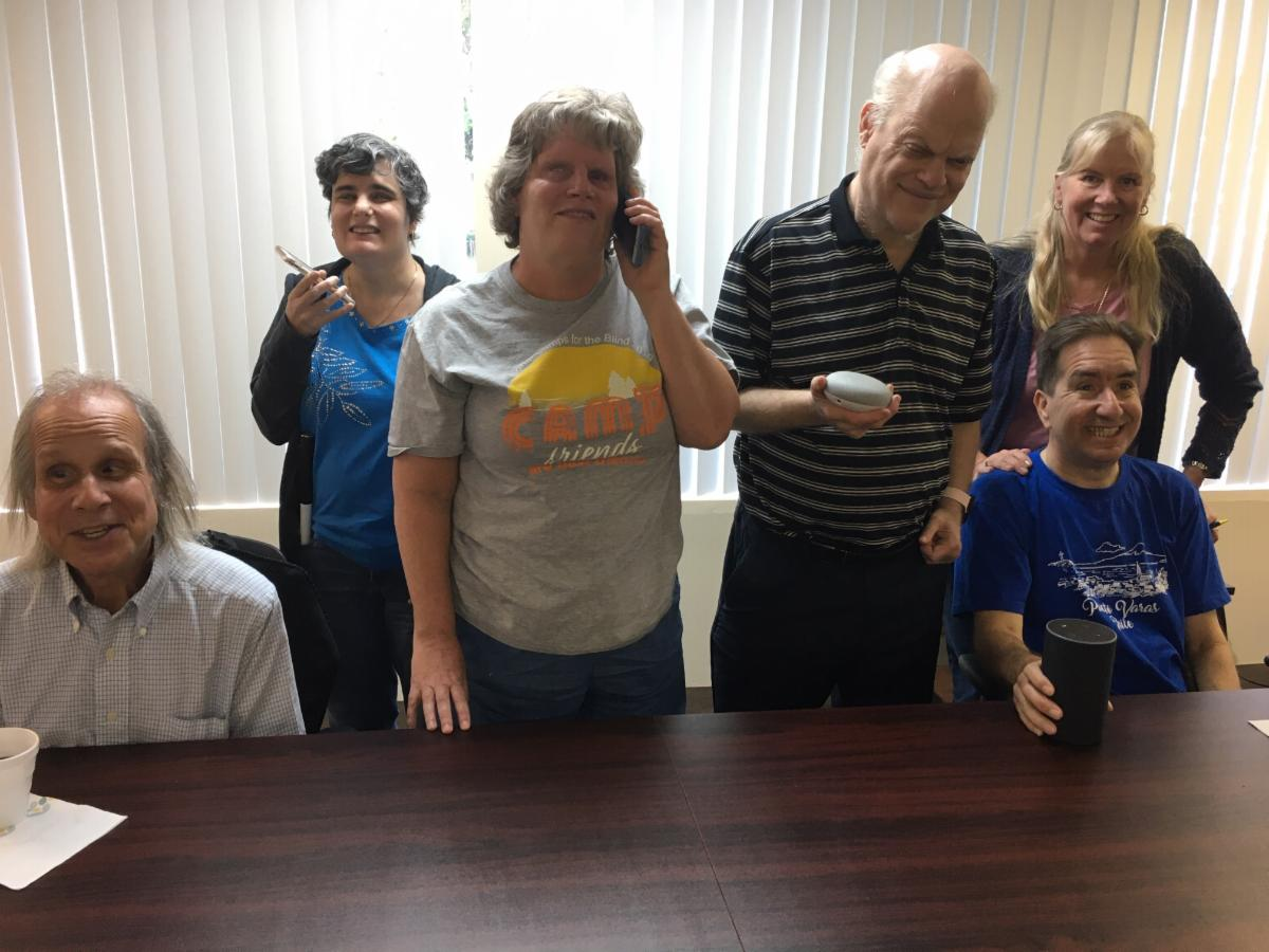 5 students with instructor Diane using voice assistants - cell phones, google and echo