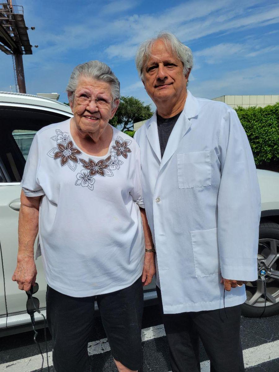 Dr. Scott Gartner with a female patient.