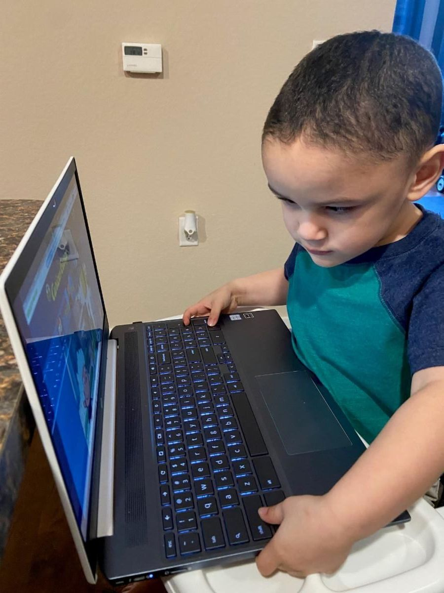 Young blind boy looking at computer