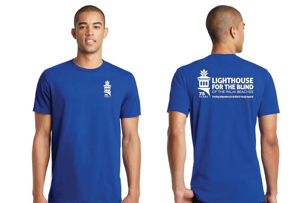 a young man posting in a blue Lighthouse t-shirt showing front and back of shirt