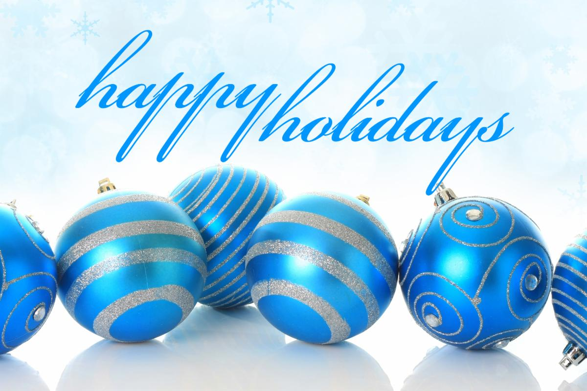 happy holidays in cursive writing with 6 blue ornaments