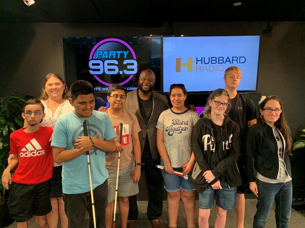 A group of teens at Hubbard Radio Station tour