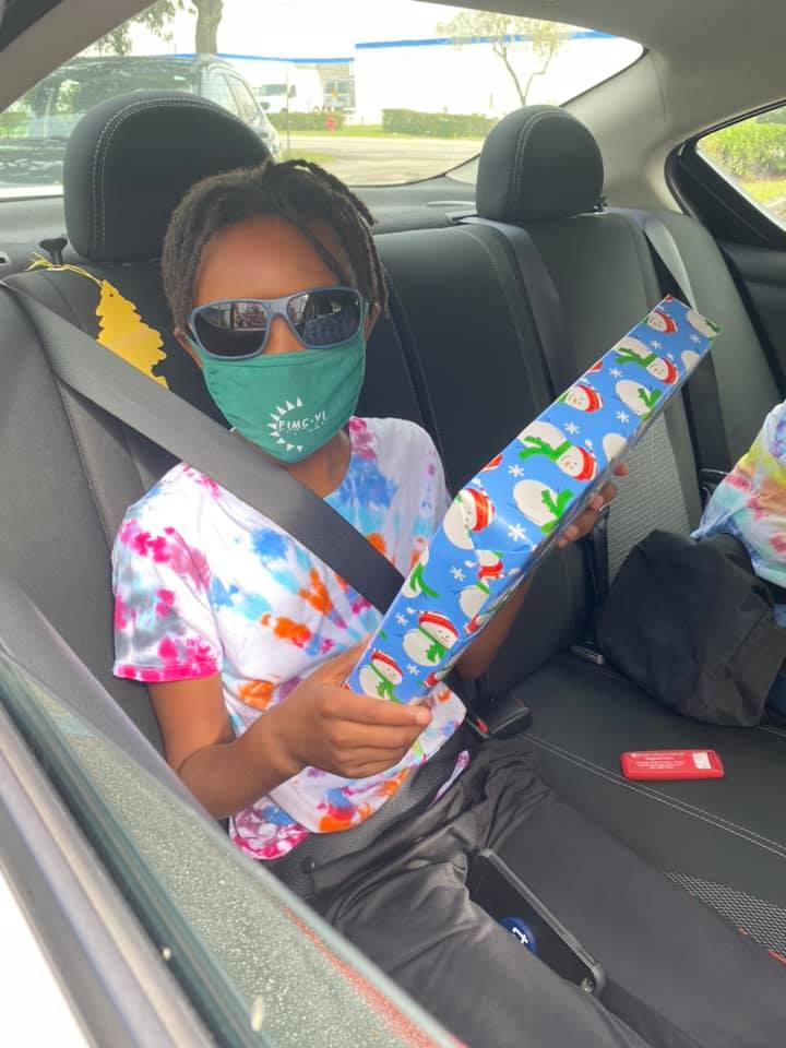Miles with a mask on receiving a gift