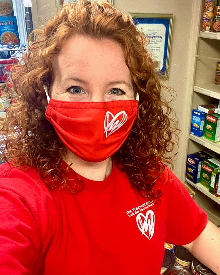 Sara wearing her Heart of Helping Superhero Mask