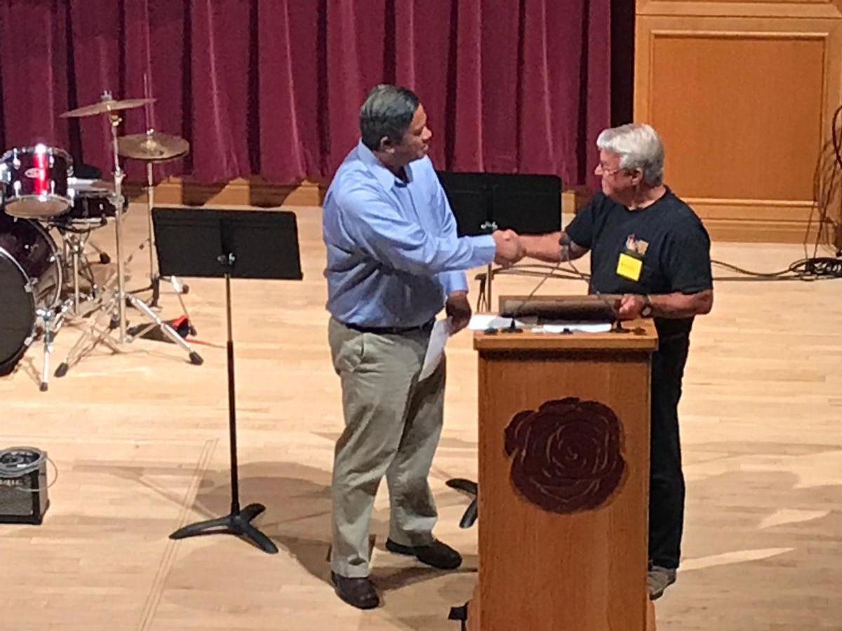 Nelson Garcia of Channel 9News receiving Appreciation Award from BMTL board co-chair David Necker