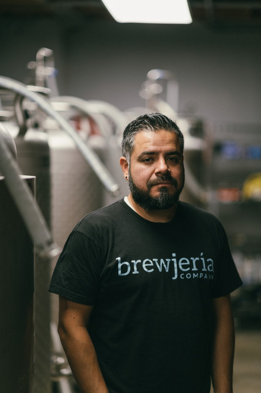 "Man in a brewery wearing a ""brewjeria"" shirt"