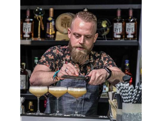 mixologist making specialty drinks