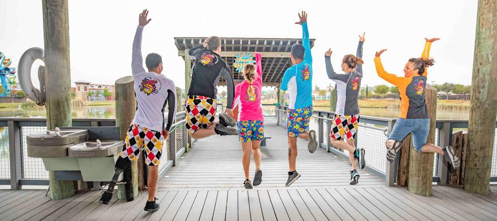 people jumping in photo wearing pirate shorts and shirts