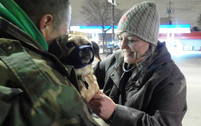 Veterinarian Stacy Lempka treats a guest_s dog at the Humboldt Park Health Outreach Bus stop