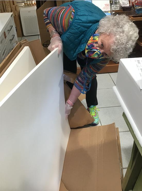 Marie helping unpack the mat board