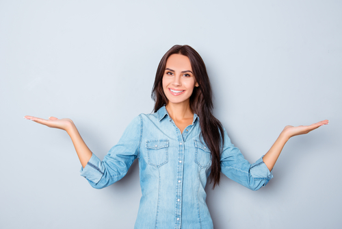 Happy smiling woman gesturing with hands and showing balance