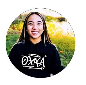 Student poses in Oaxaca sweatshirt design