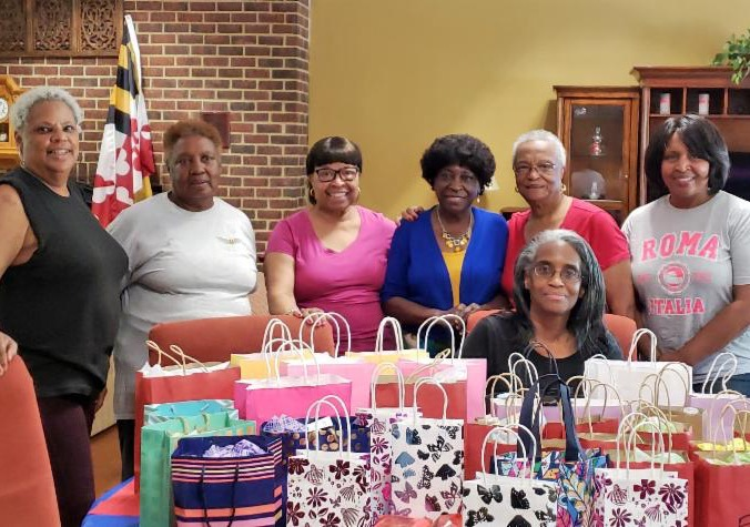 group of ladies with gift bags