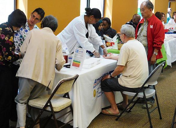 Seniors visiting booth at health fair