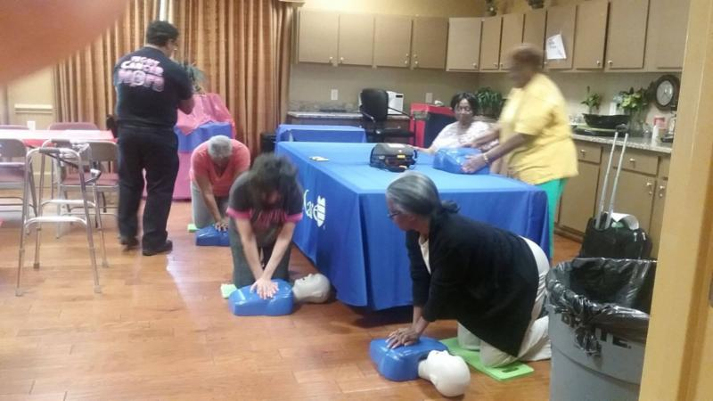 people participating in CPR training