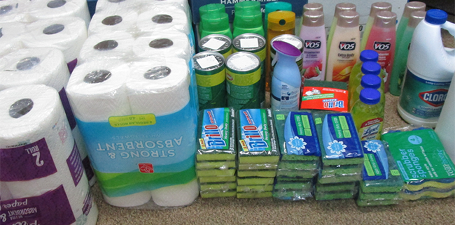 variety of cleaning products stacked together on the floor