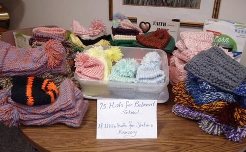knitted hats displayed on a table