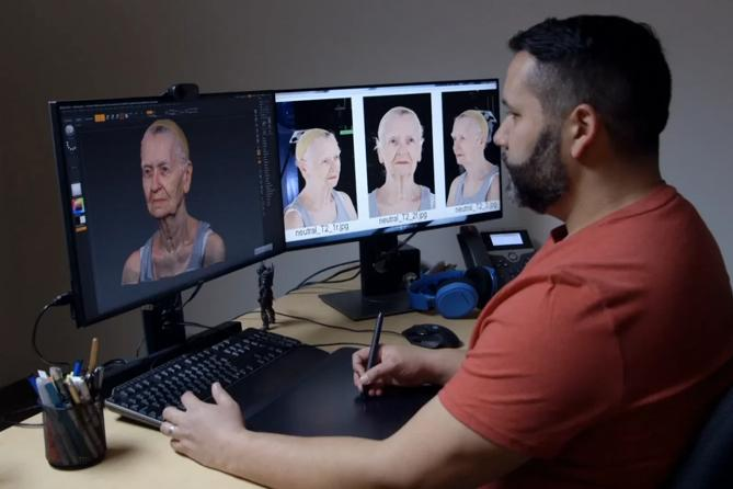 man at 2 screen computer