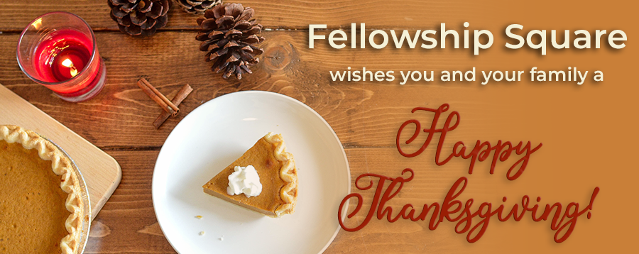 Happy Thanksgiving message on wood background with pumpkin pie