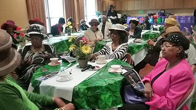 senior luncheon with ladies in fancy hats