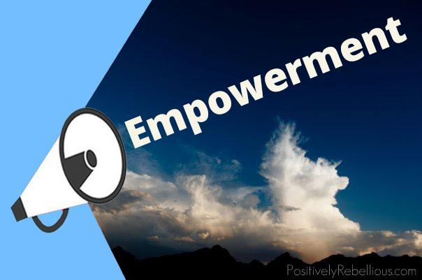 megaphone shouting the word empowerment over a deep blue sky background with clouds