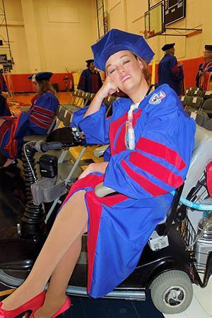 Josie Badger in graduation cap and gown.