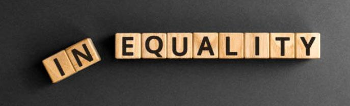 """block letters spelling out """"inequality"""" with first two letter, """"in"""" tilted and falling downward."""