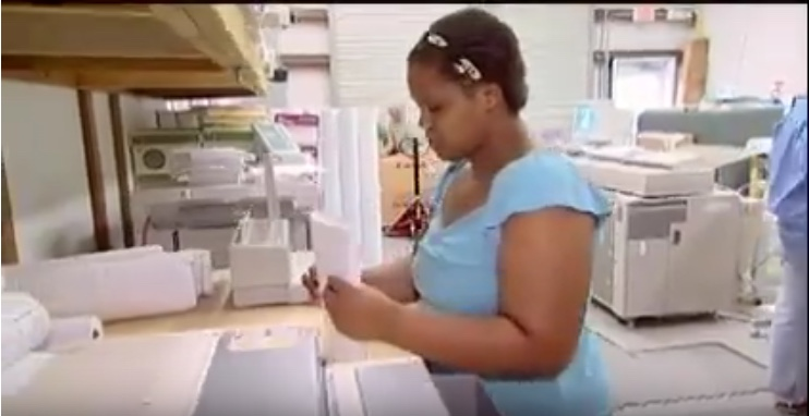 young African American woman working in a bindery