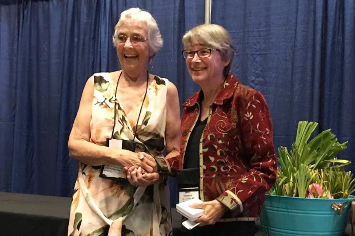 Karol Emmerich receiving Bertrand Farr Silver Medal